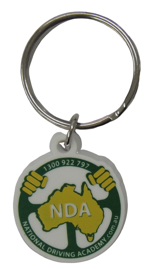 Rubber key ring for driving academy with 3 colour logo on front in 2D.