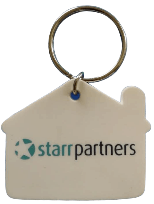 Rubber key rings in house shape for real estate property company with 2 colour printed logo.