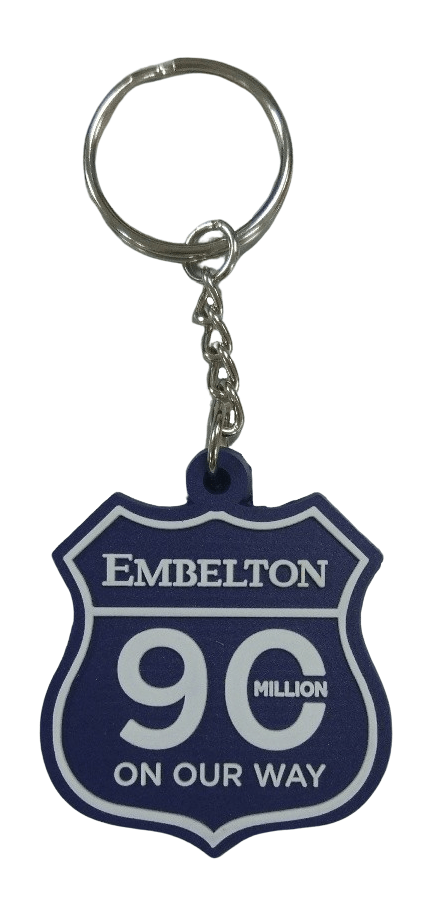 Custom shape rubber keyring for manufactering company with 2 colour logo in 2D.