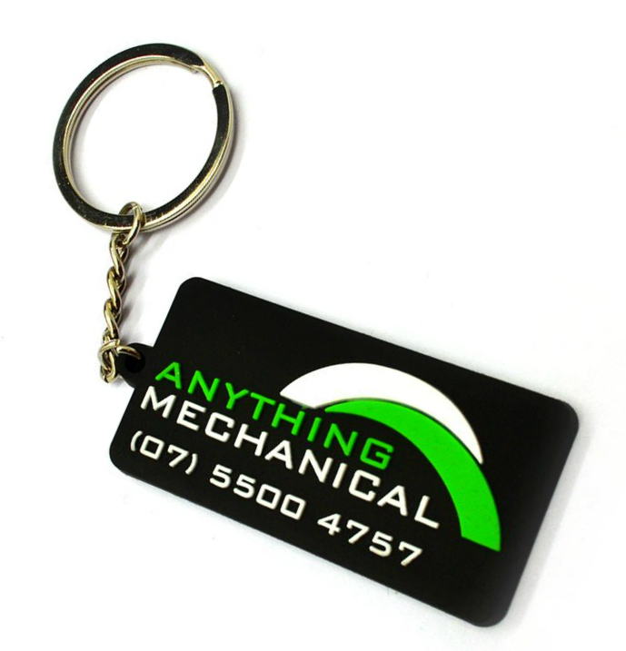 Custom rubber key rings for a motor mechanic business with a 2D logo on the front painted in green and white.