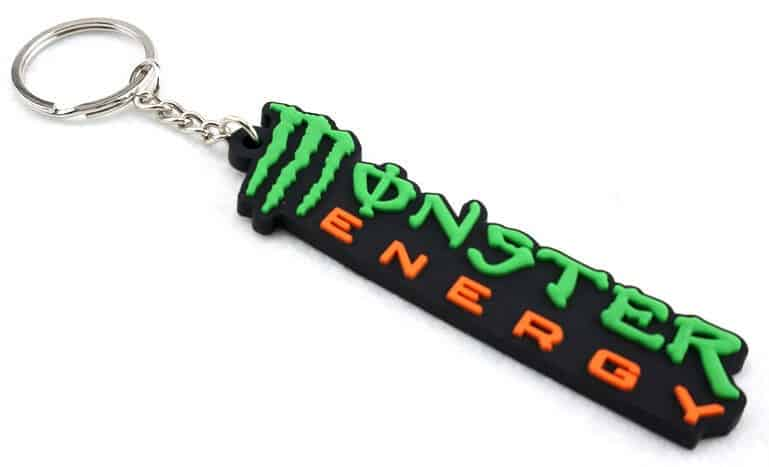 Custom rubber keychain with 2 colour logo. The lettering is Monster Energy.