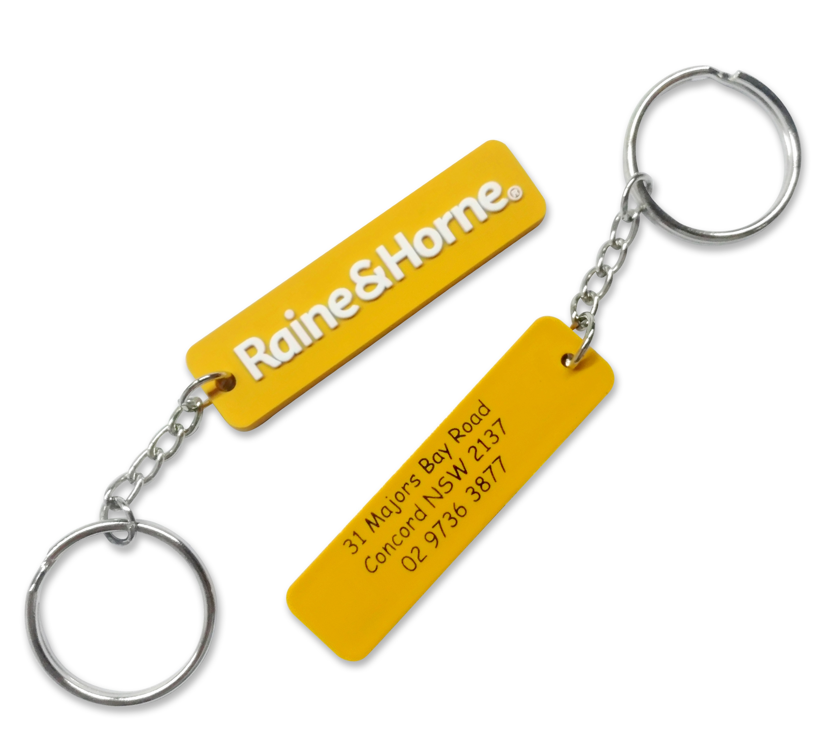 Yellow personalised rubber keyrings for a real estate company with 2D logo in white on the front and company contact details prtined in black on the back.
