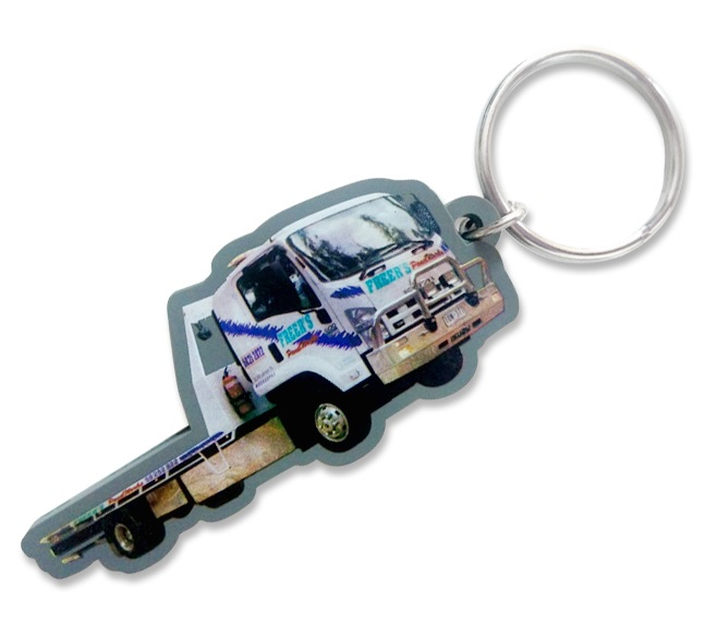 Truck shaped personalised rubber keyring with a full colour photo printed logo on the front.