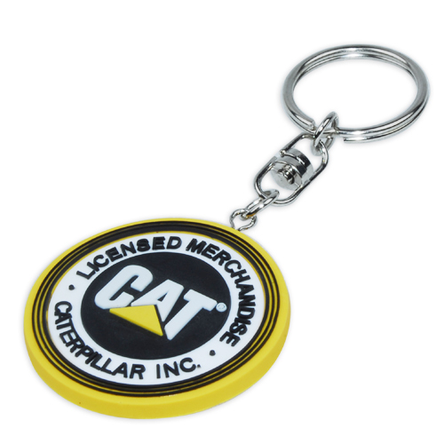 Circular custom rubber keyring for Caterpillar Inc corporation.