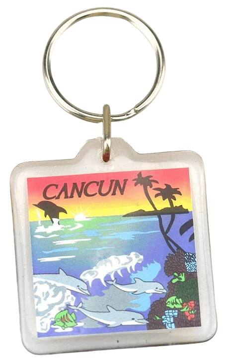This is a square acrylic keyring with a photo of a tropical beach printed on the paper insert.