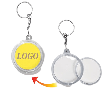 This shows how a logo insert is applied to a circle shaped acrylic keyring.
