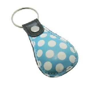 Custom leather keyring in oval shape with white dots painted onto the leather.