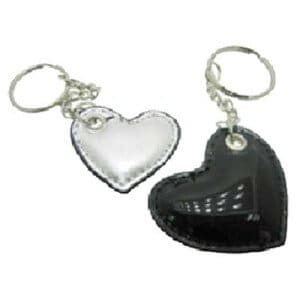 Custom leather keyring in the shape of a heart.