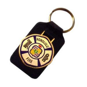 Leather keyring with a custom metal logo attached to the leather.