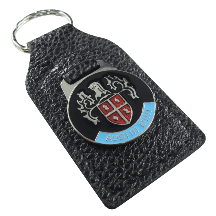 Custom leather keyring for a car brand. It has a metal coloured logo.