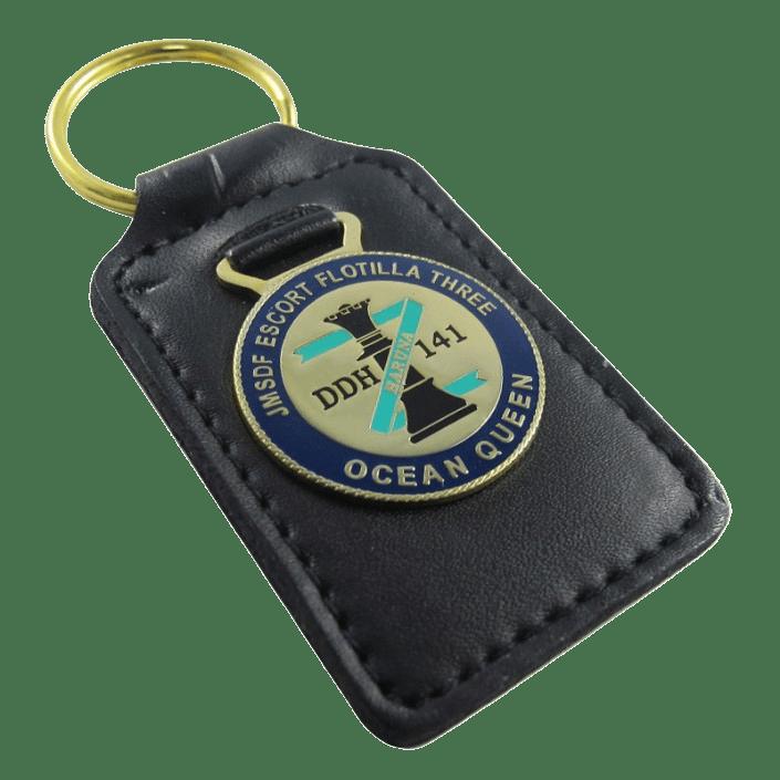 Custom leather keychain with a metal circular coloured logo.