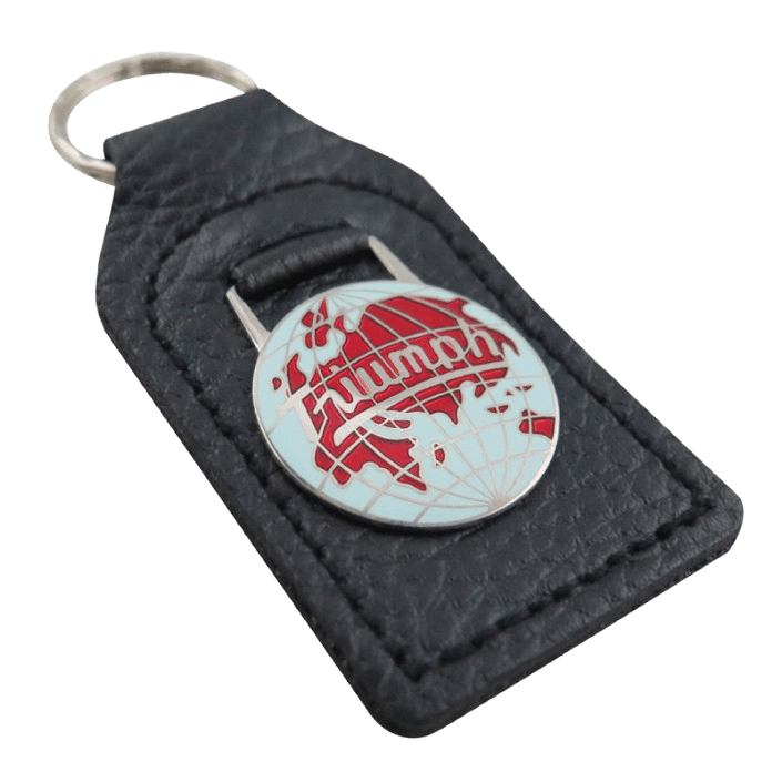 Custom leather keyring with a global shaped metal logo attached.