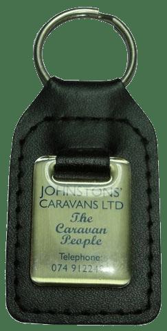 Custom leather keyring with a metal stamped logo for a caravan dealership.