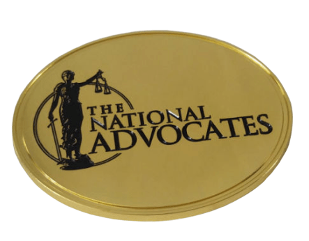Oval shaped custom metal badge in gold finish. It has a laser engraved log in black.