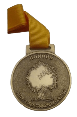 Custom made medals given to celebrate honors awards at a student college. It has an antique metal and bronze coloured ribbon finish.