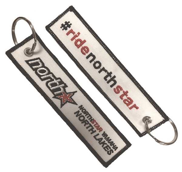 Custom embroidered keyring for a motorcycle dealer. It features a 2 colour logo stiched on both sides.