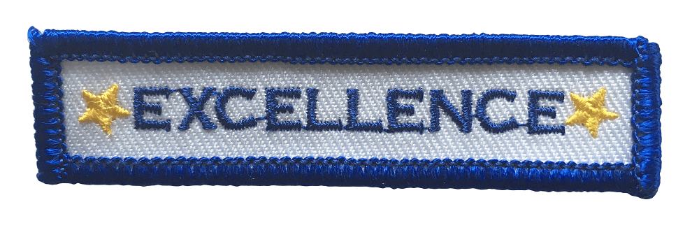 Personalised embroidered patch with EXCELLENCE written in blue and a yellow star on either side of the wording. It has white background, blue lettering and blue merror border around the edge.