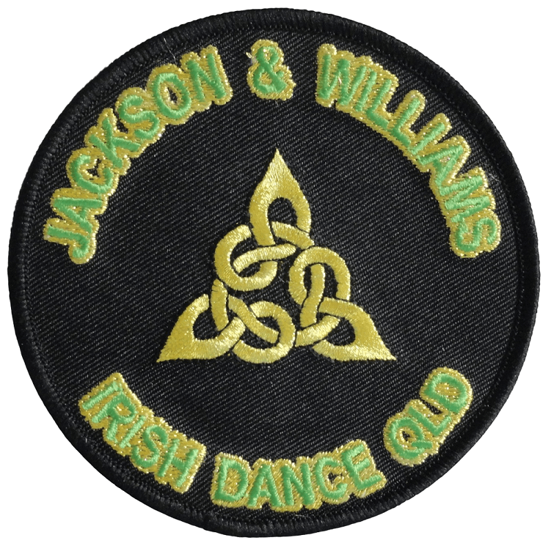 Circular embroidered patch for a dance club with black backing. It has green embroidered lettering with yellow outline and logo symbol in the middle.
