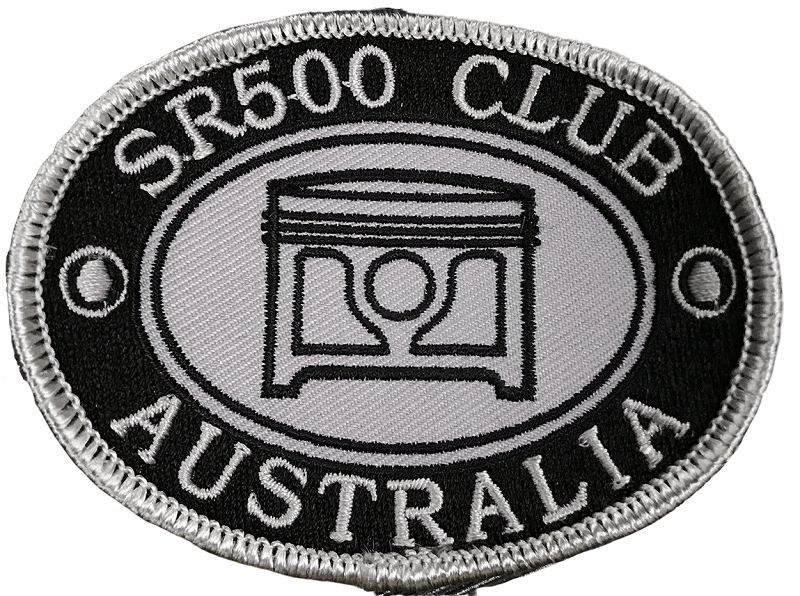 Embroidered clothing patch for a car enthusiast club. It has a black background and silver stitching for the lettering, logo and patch border.