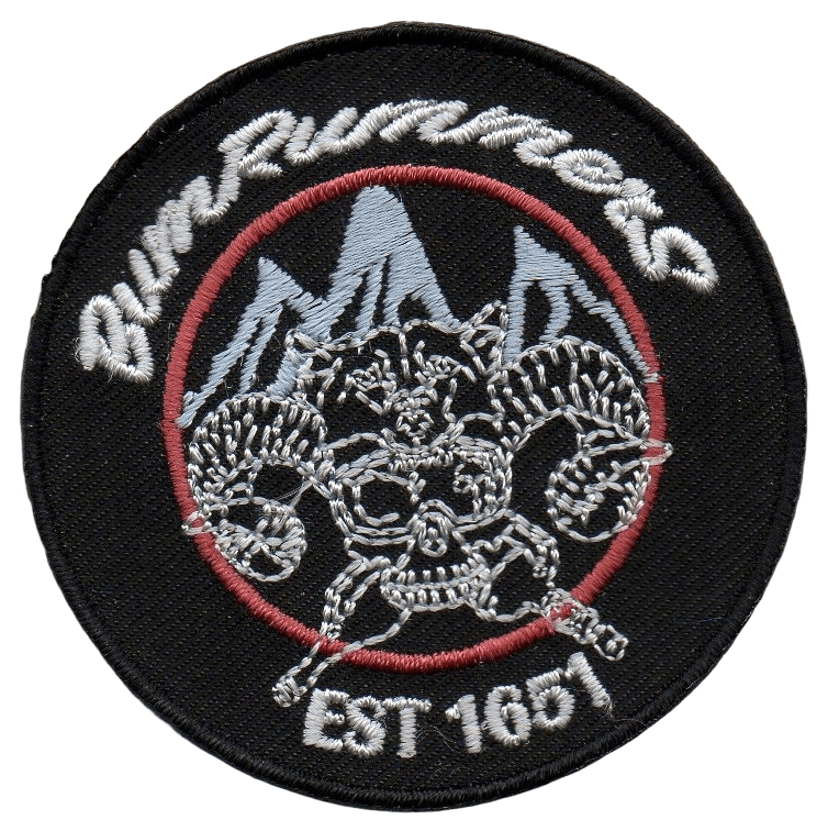 Circular embroidered patch featuring a complex design for a niche clothing brand.