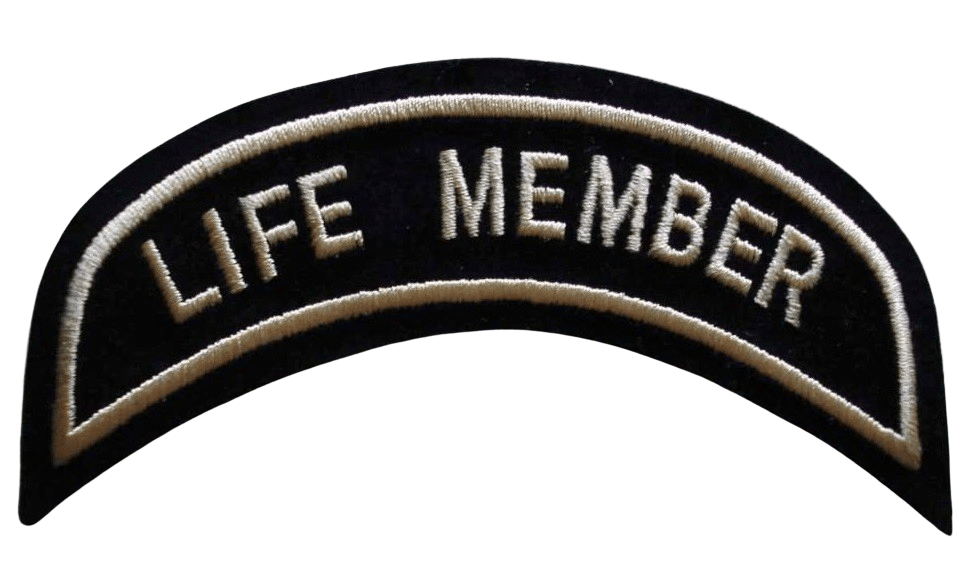 Simple custom embroidered clothing patch in contoured shape with the wording LIFE MEMBER stiched into the front of the design.
