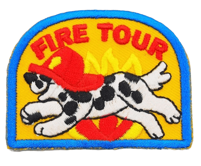 Custom embroidery label for a fire tour business. It features a black spotted dog with a fireman hat and the wording FIRE TOUR in red embroidered on the top of the design.