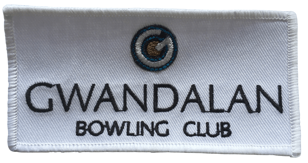 Custom embroidered patch in rentangular shape for a local bowling club. It features a circlular logo and bold lettering in dark blue embroidered.