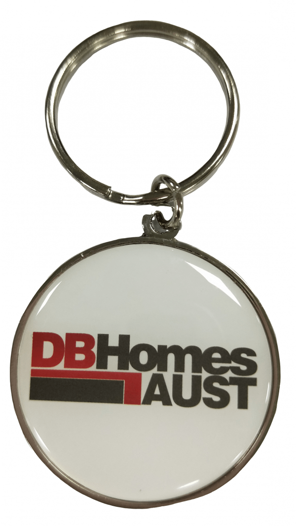 Custom metal keyring in circle shape with a printed logo for a building company.