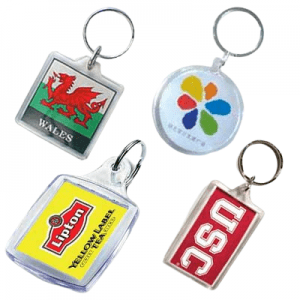 Various shaped acrylic keyrings with a printed logo insert.