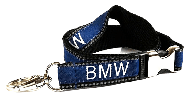 Reflective lanyard with metal breakaway accessory and oval shaped swivel hook.