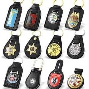 Various custom leather keyring designs with black double layer leather. They all feature a custom metal logo to create that official impression.