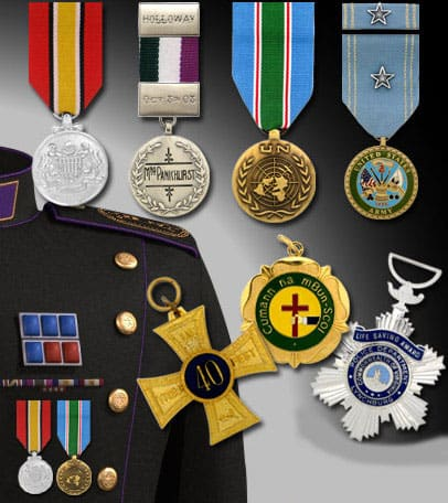 Various custom medallion designs that include a fabric ribbon drape for attaching to clothing.