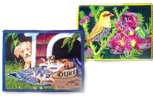 High resolution embroidered patches of dog at kennel and bird in a tree.