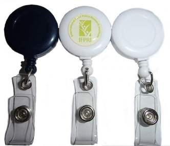 3 lanyard pull reels in black, white with gold logo and plain white.