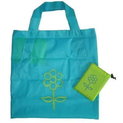 Light blue coloured personalised folding shopping bag in polyester taffeta with PA coating material. It has 1 colour logo printed on both sides and folds into a neat compact pouch with a plastic fastener.