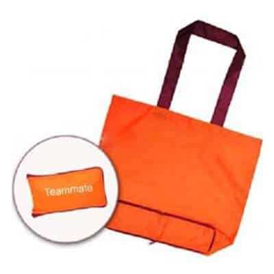 Orange coloured personalised folding shopping bag in terylene material. It has a 1 colour logo printed and folds into a neat compact pouch.