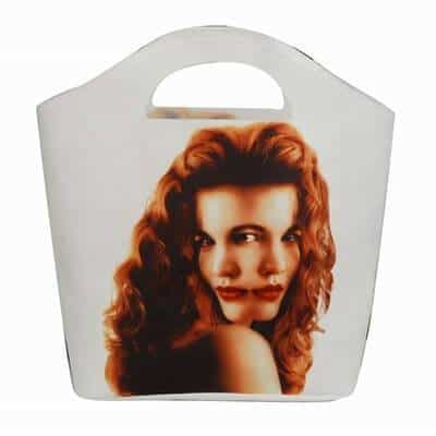 Non woven shopping bag with a picture of a lady in 3D effect with red hair. Material: 110g PET Non-woven. Size: 38*40*10cm. Logo: Heat-transfer printing.