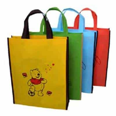 A selection of custom printed no woven bags in various colours. The material is 80g non-woven.