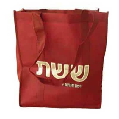 Red custom non woven bag with a heat transfer logo.