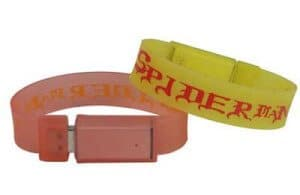 Personalised Silicone Wristband with printed artwork and USB storage drive. Orange and yellow band examples is pictured.