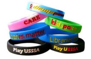 ersonalised Silicone Wristband in numerous colours with recessed (debossed) artwork and colour filled lettering. Details:100% Silicone