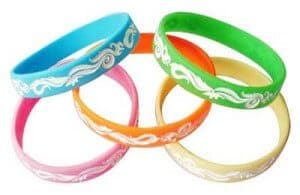 Personalised Silicone Wristband with recessed (debossed) artwork and white filled design.