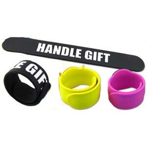 Custom silicone slap band with embossed logo. Black, yellow and pink band colour options are pictured.