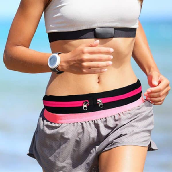 Lady jogging with womens sports waist bag.