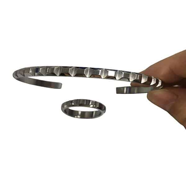 Slimline stainless bracelet with a shape formation around the outer side.