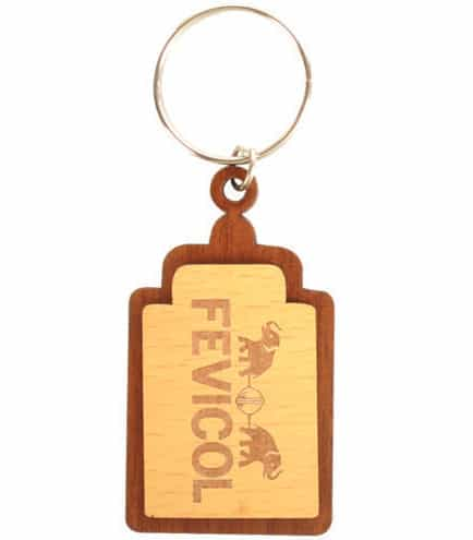 Personalised wooden keyring with laser engraved logo which features letters and animal pictures.