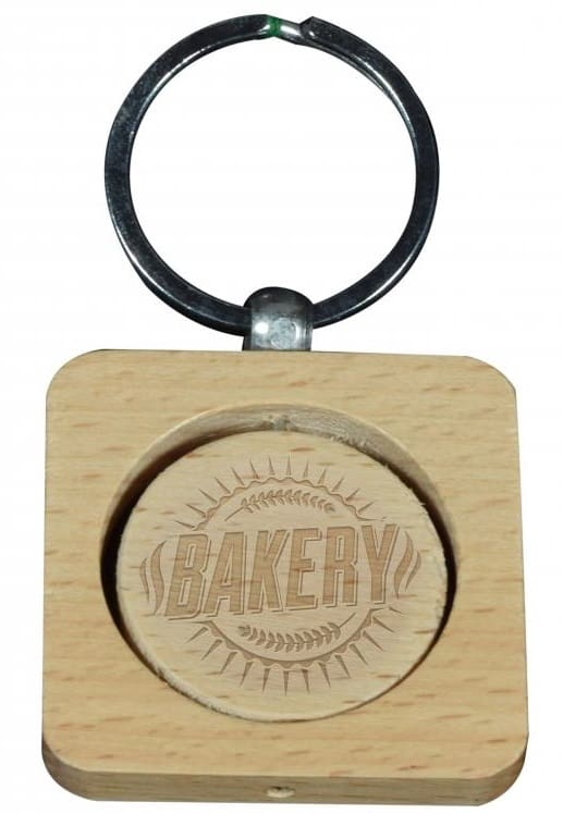 Rectangular cusotm wooden keyring with circular logo section and engraved logo.