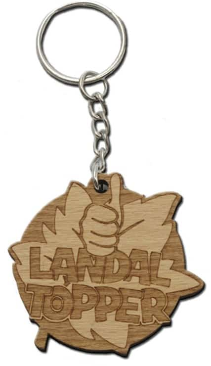 Various custom wooden keyring designs which can be ordered from QW Direct