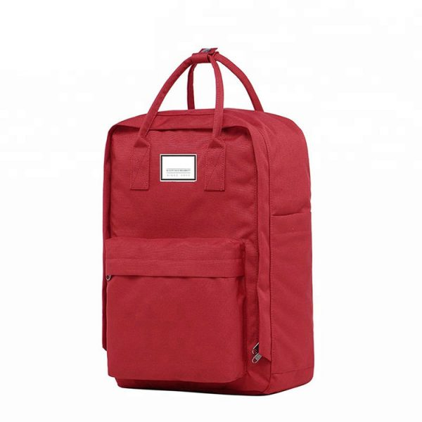 Red casual laptop backpack showing the front view.