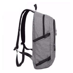 Side view showing grey waterproof school backpack.